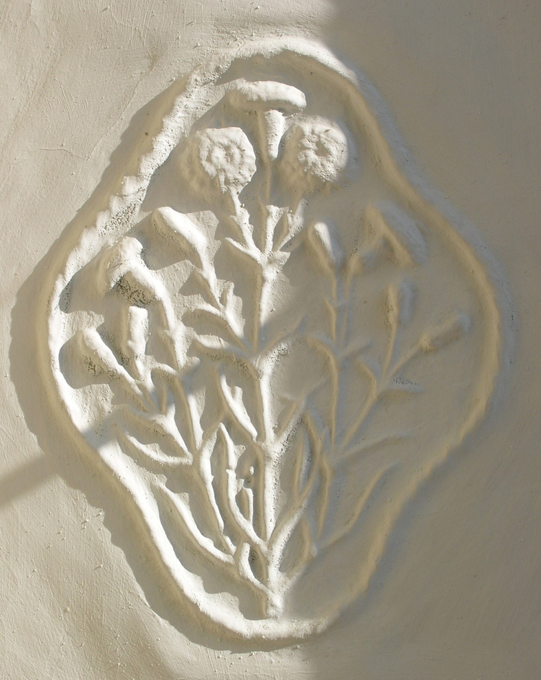 Plaster flower design in the hall at Owlpen