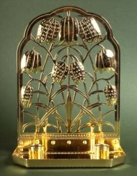 Brass 'fritillary' pattern sconce at Owlpen